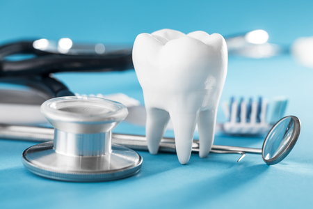White healthy tooth, different tools for dental care. Dental background.