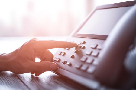 Support de communication, centre d'appels et help desk du service client. Utilisation d'un clavier de téléphone.