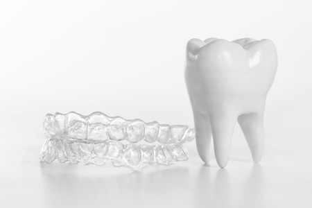 Inivisalign braces or aligner. A way to have a beautiful smile and white teeth. 版權商用圖片