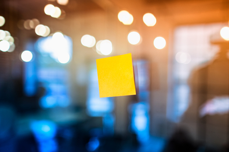 Self adhesive notes stuck on the glass in the office. Brainstorming concept.