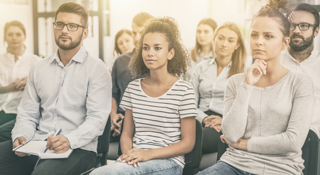 Business conference concept. Young people sitting together on conference and listenning. Multiethnic community. Imagens - 111176904