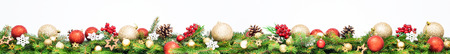 Extra wide Christmas border with golden and red baubles, fir branches, pine cones and red rowan isolated on white background.