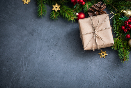 Christmas Card: Xmas or New Year with decorations and gift boxes on stoned background.