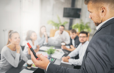 Business coach. Team leader teaches employees at a business meeting in a conference room. Stock Photo