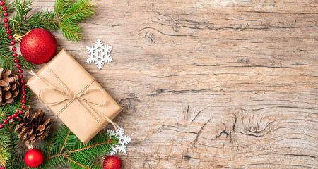 Christmas Card: Xmas or New Year with decorations and gift boxes on wooden background. Stock Photo