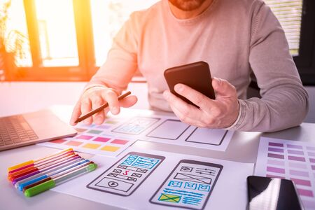 Designers man drawing website ux app development. User experience concept.