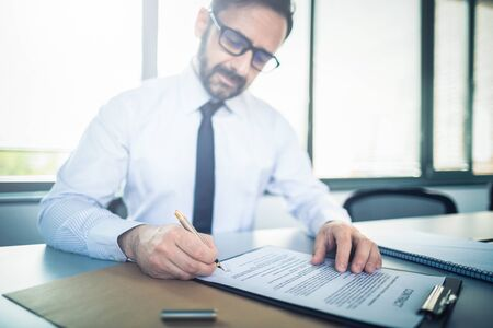 Business man signing contract document on office desk, making a deal. Stock Photo - 125868422