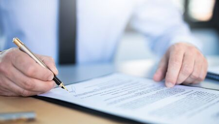 Business man signing contract document on office desk, making a deal. Stock Photo - 125868426