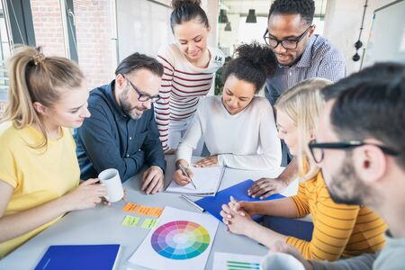 Young business people meeting at office and discussing together a new startup project. Stock Photo
