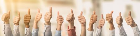 Hands showing the thumb and the symbol ok. Concept of winning people, winners. Stock Photo