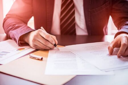 Business man signing contract document on office desk, making a deal. Stock Photo - 127591604