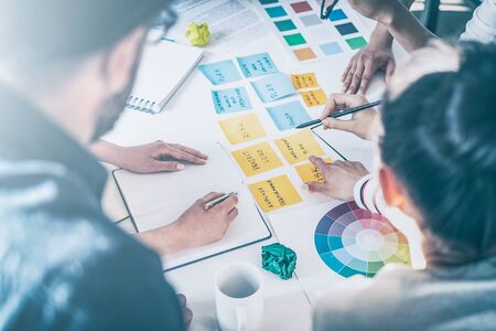 Business people meeting at office and use post it notes to share idea. Brainstorming concept. Stock Photo