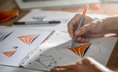 Graphic designer drawing sketches design. The concept of a new brand. Professional creative occupation with idea. Stock Photo