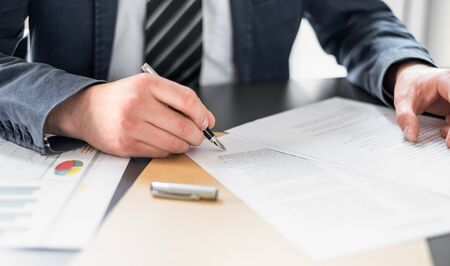 Business man signing contract document on office desk, making a deal. Stock fotó