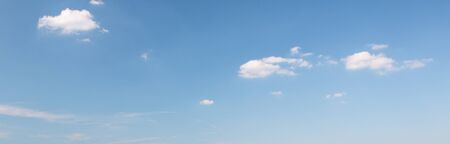 Sky blue background. Natural background with beautiful white clouds. Stock Photo