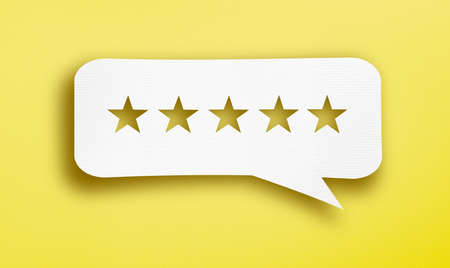 Bubble speech with cut out star in the paper. Feedback, rate, satisfaction customer and user concept. Stock Photo