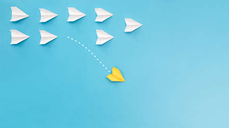 New ideas creativity and different innovative solution. Business concept. A group of paper airplanes, one plane is flying in the other direction, different way.