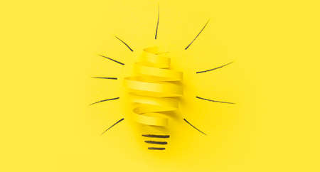 Creative new idea. Innovation, brainstorming, inspiration and solution concepts. Light bulb with crumpled paper on blue background. Stock Photo