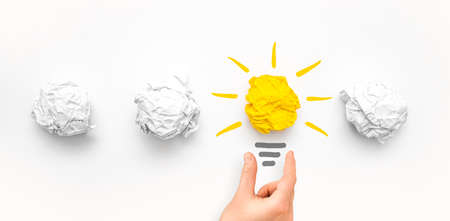 Creative new idea. Innovation, brainstorming, inspiration and solution concepts. Light bulb with crumpled paper on white background. 写真素材