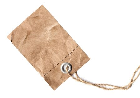 tagged: Blank label hanging on a rope, made of old brown paper Stock Photo