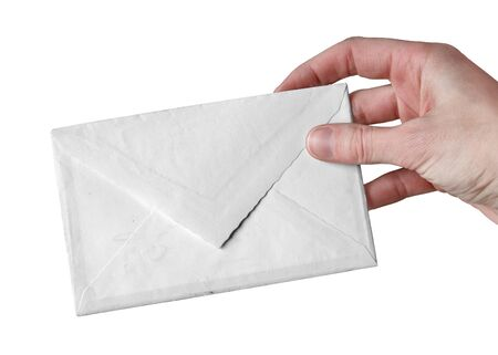 Hand holding a blank white envelope, isolated on white background.