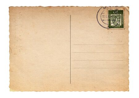 Backside of a blank vintage postcard with stamp in the corner, isolated on white background