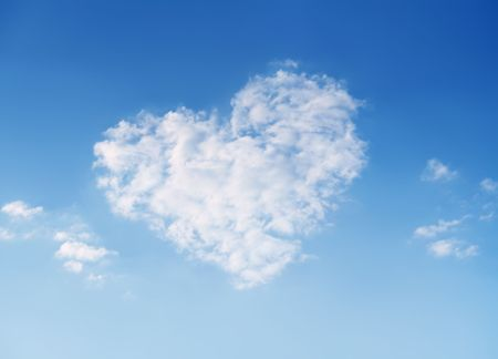 Heart shaped cloud on beautiful blue sky