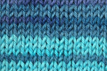 Close-up of colorful knitted wool texture.
