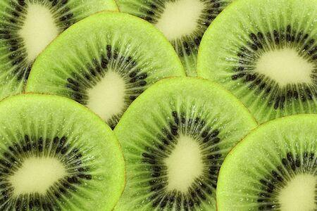 Bright green background of fresh Kiwi slices