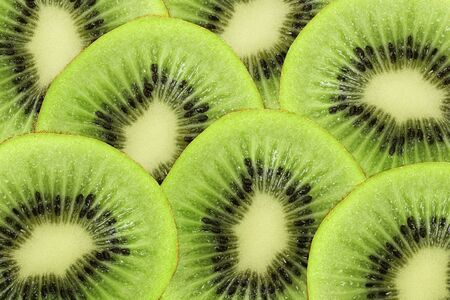 Bright green background of fresh Kiwi slices