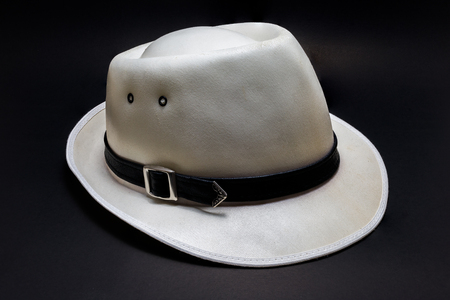 stetson: White cowboy hat isolated on black background closeup