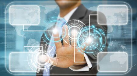 Businessman touching tactile screen photo