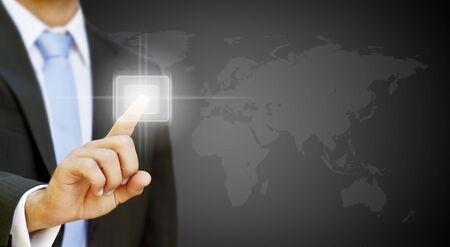 Businessman pressing digital screen photo