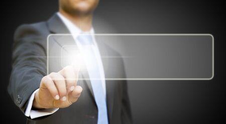 Businessman pressing digital screen