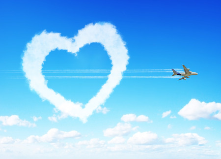 Fluffy love clouds on blue sky background photo