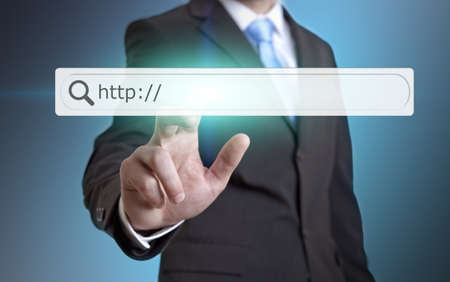 Businessman using internet on a digital screen photo