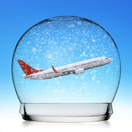 Snowball travel concept with a plane representing holidays photo