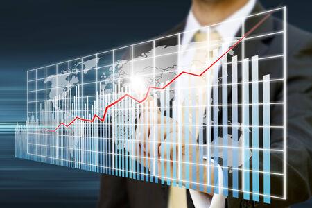 Businessman using a digital chart during a meeting photo