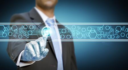 Businessman with a robot hand using a digital interface