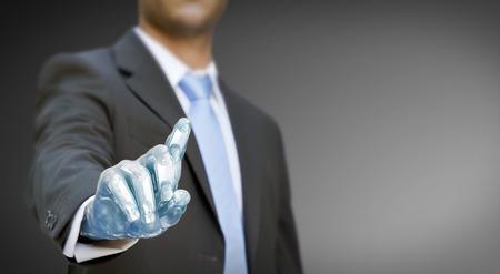 web robot: Businessman with a robot hand using a digital interface