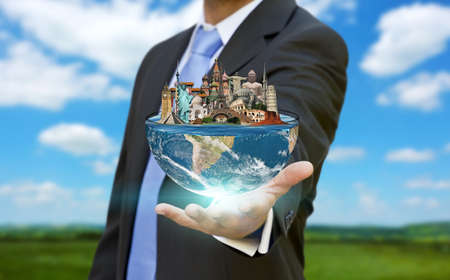 Businessman choosing his holidays with half planet earth in his hands