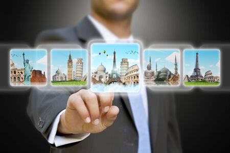 Businessman choosing his holidays on a digital screen photo