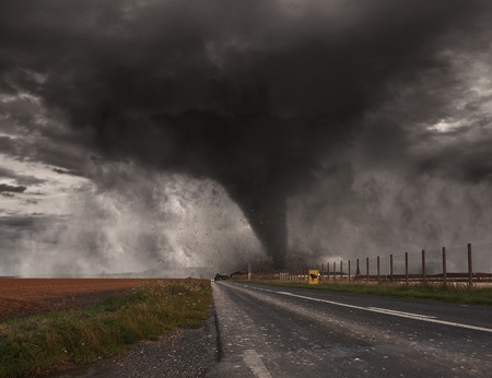 end of the world: Picture of a large tornado destroying the landscape Stock Photo