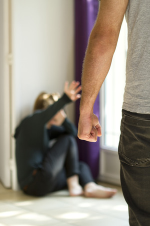 domestic violence: Man beating up his wife illustrating domestic violence