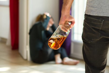 Man beating up his wife illustrating domestic violence