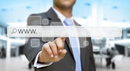 Businessman cliking on tactile interface web address bar
