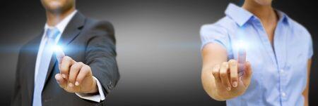 businesspartners: Hombre y mujer que usa interfaz digital Foto de archivo