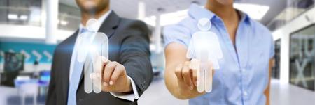 男と女の大きな青いオフィスのデジタル インター フェースを使用して 写真素材