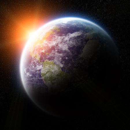일출 동안 우주에서 지구의보기