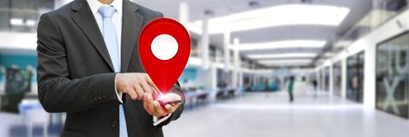 digital world: Businessman with digital map and pins floating over his hand